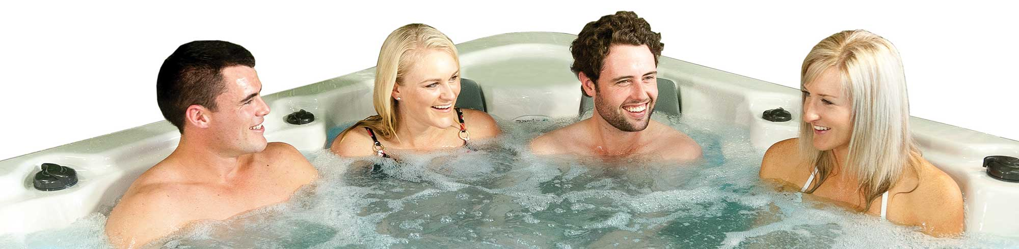 four people in an Oasis spa pool